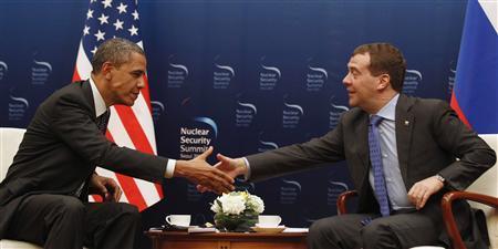 U.S. President Barack Obama shakes hands with Russian President Dmitry Medvedev in Korea