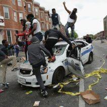 riots_baltimore-2015-dance-on-car